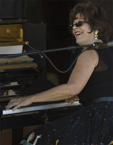 Caroline playing boogie woogie piano at Rancho Nicasio