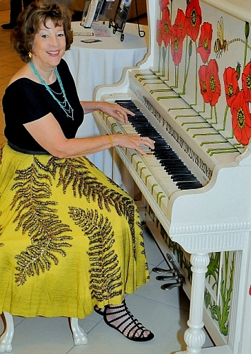 Caroline playing boogie woogie piano in Florida